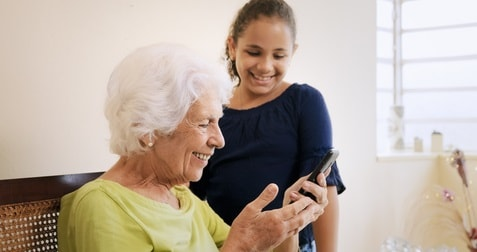stockfresh_8217002_girl-helps-old-woman-using-mobile-phone-and-technology_sizeXS (1)-min.jpg